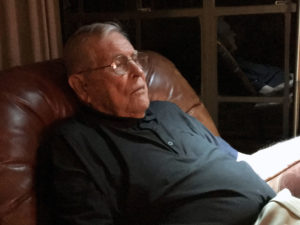 Eddie Robinson relaxes while watching Game 2 of the World Series.